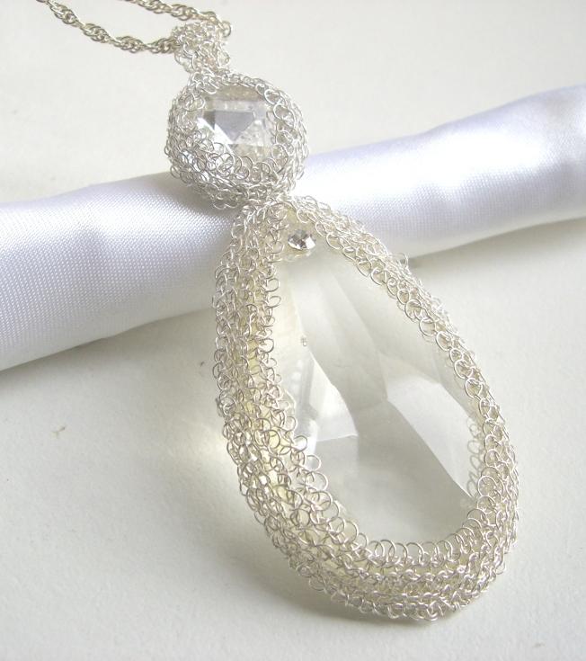 Cristales engastados en hilos de plata 999,9